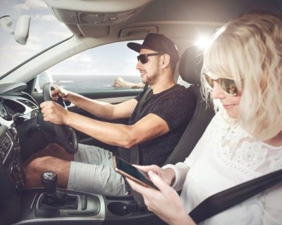 Drivers fined for passengers using mobile phones